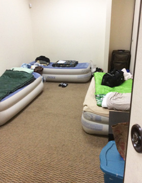 A sleeping room for three guests in St. Dunstan's youth building (Photo by Ken Denbow)