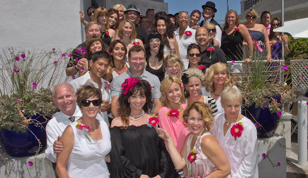 The staff of Indigo at the 2012 Keep a Breast fundraiser, owners Phyllis Strauss and Randi Hosking are lower left, respectively, Oscar Melero is two rows above them. (Courtesy Indigo Salon and Spa)