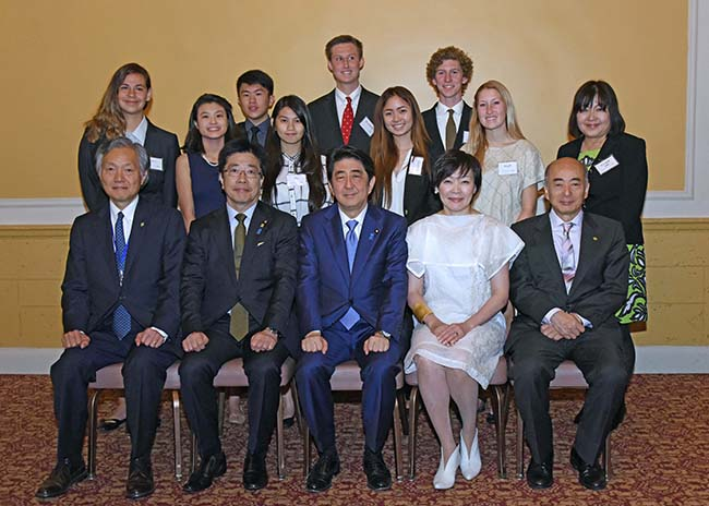 PHHS students pose with members of the Japanese delegation, including Prime Minister Shinzo Abe (center) (Courtesy PHHS)