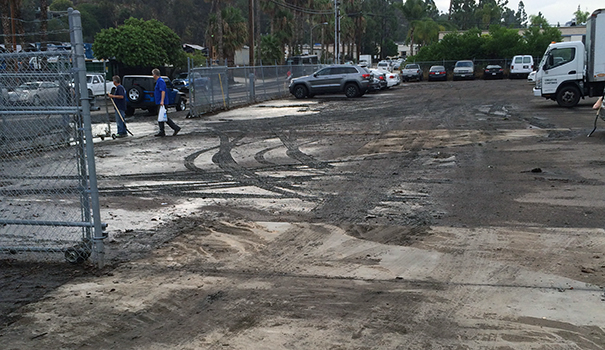 A commercial parking lot was covered with mud after July rains. (Courtesy Randal Densley)