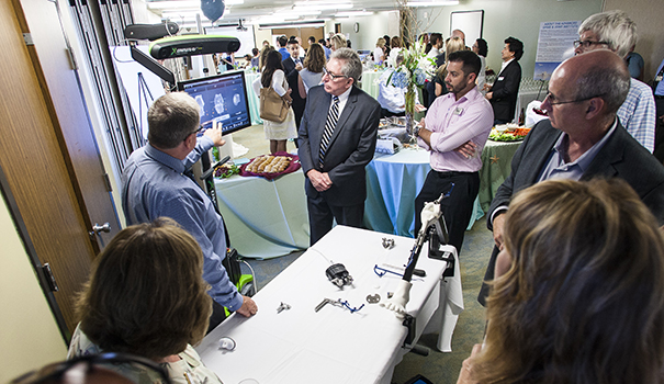 Guests at the grand opening of the new Alvarado Hospital Spine and Joint Center are shown how the robotic-assisted knee surgery technology works. (Photo courtesy of Alvarado Hospital)