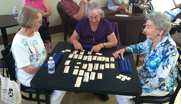 (l to r) Penny Berridge, Naomi Title and Gerda Helibrunn enjoy a card game at the College Avenue Center. (Photo by Doug Curlee)