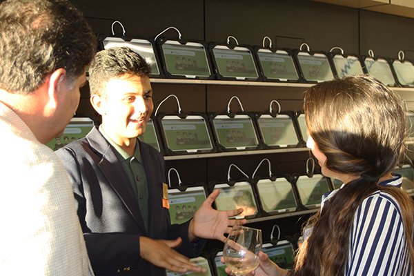 JA Student Ambassador Bunse Patel explains Finance Park technology to guests at the Oct. 1 opening. (Photo by Jeff Clemetson)
