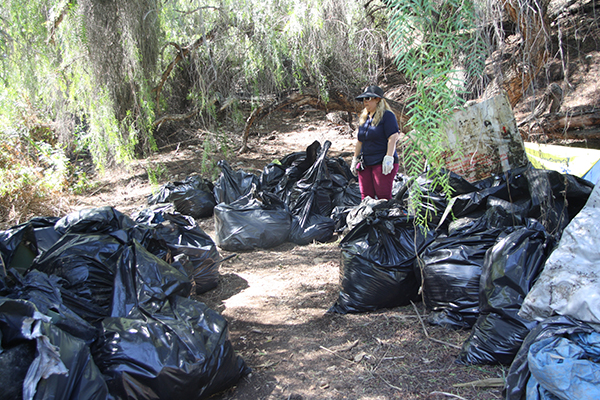 Volunteers from Girl Scout Troop 4253 lend a hand to the river cleanup effort. (Photo by Jeff Clemetson)