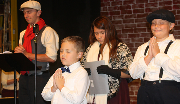 (l to r) Danny Deuprey as Bob Cratchit; Max Patag as Tiny Tim; AndreAna Canales as Martha; and James Patag as Peter Cratchit. (Photos by Jeff Clemetson)