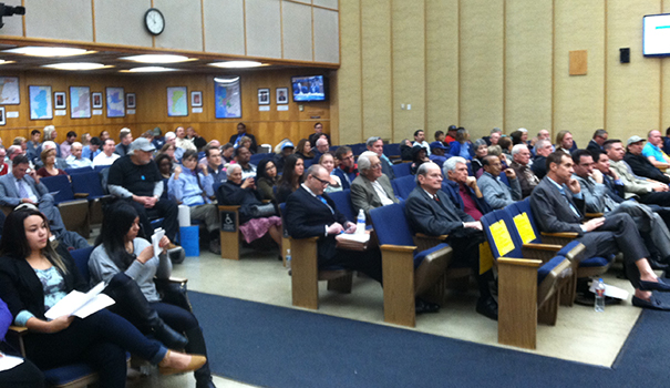 San Diego residents wait to comment on the water rate hike at the City Council meeting on Nov. 17. (Photo by Doug Curlee)