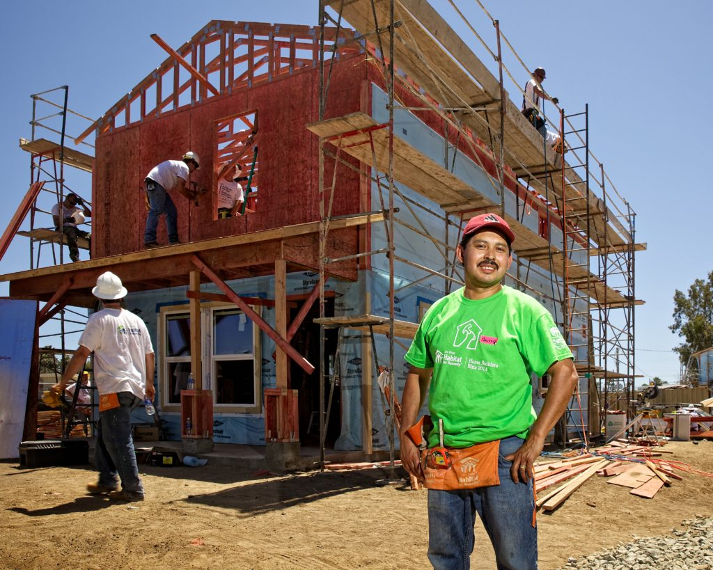 Pastor Nieto stands in front of his Habitat home in Escondido that was built in the summer of 2014 during Habitat For Humanity's Home Builders Blitz. (Courtesy of Habitat For Humanity)