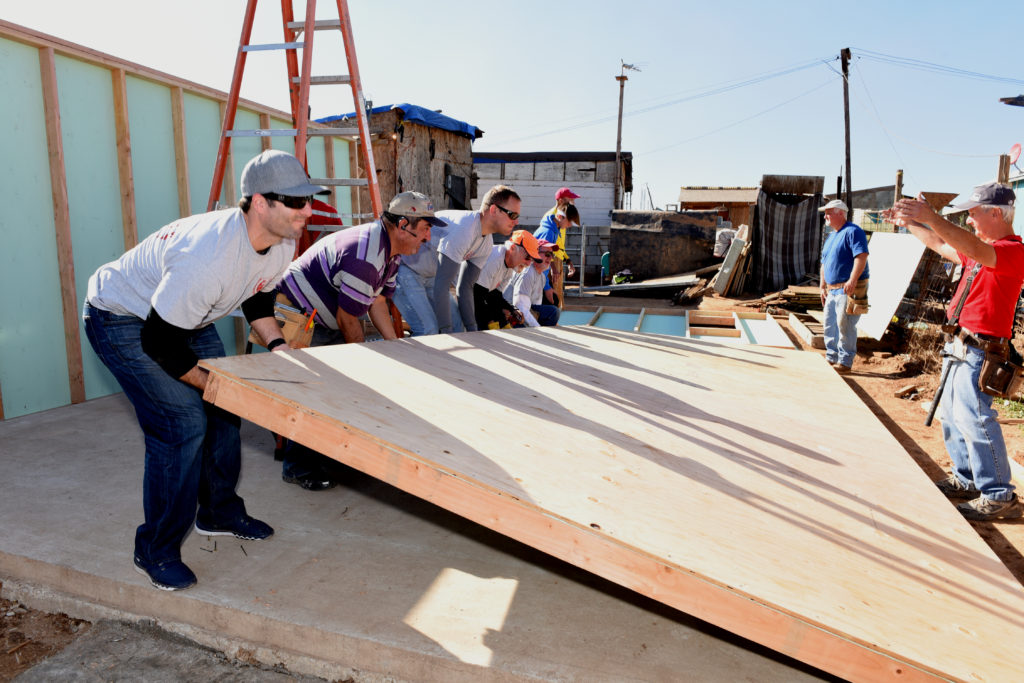 IRT team leader John Zawis (right) instructs volunteers in the construction of the new house they are building for an impoverished family in Tijuana, Mexico. (Photos courtesy of International Relief Teams)