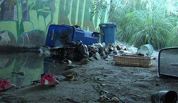 City cleans up riverbed, offers services to homeless living there tocombat hepatitis A outbreak